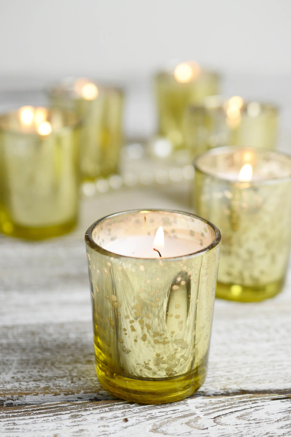 12 pre filled candles gold mercury glass votive holders for How to make glass candle holders
