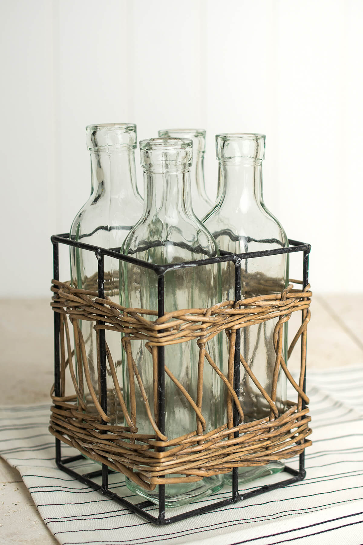 4 Glass Bottles in Willow Basket
