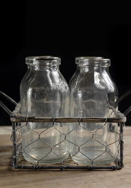 Four Glass Milk Bottles in Chicken Wire Carrier