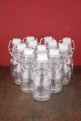 "12 -4"" Glass Swing Top Bottles"
