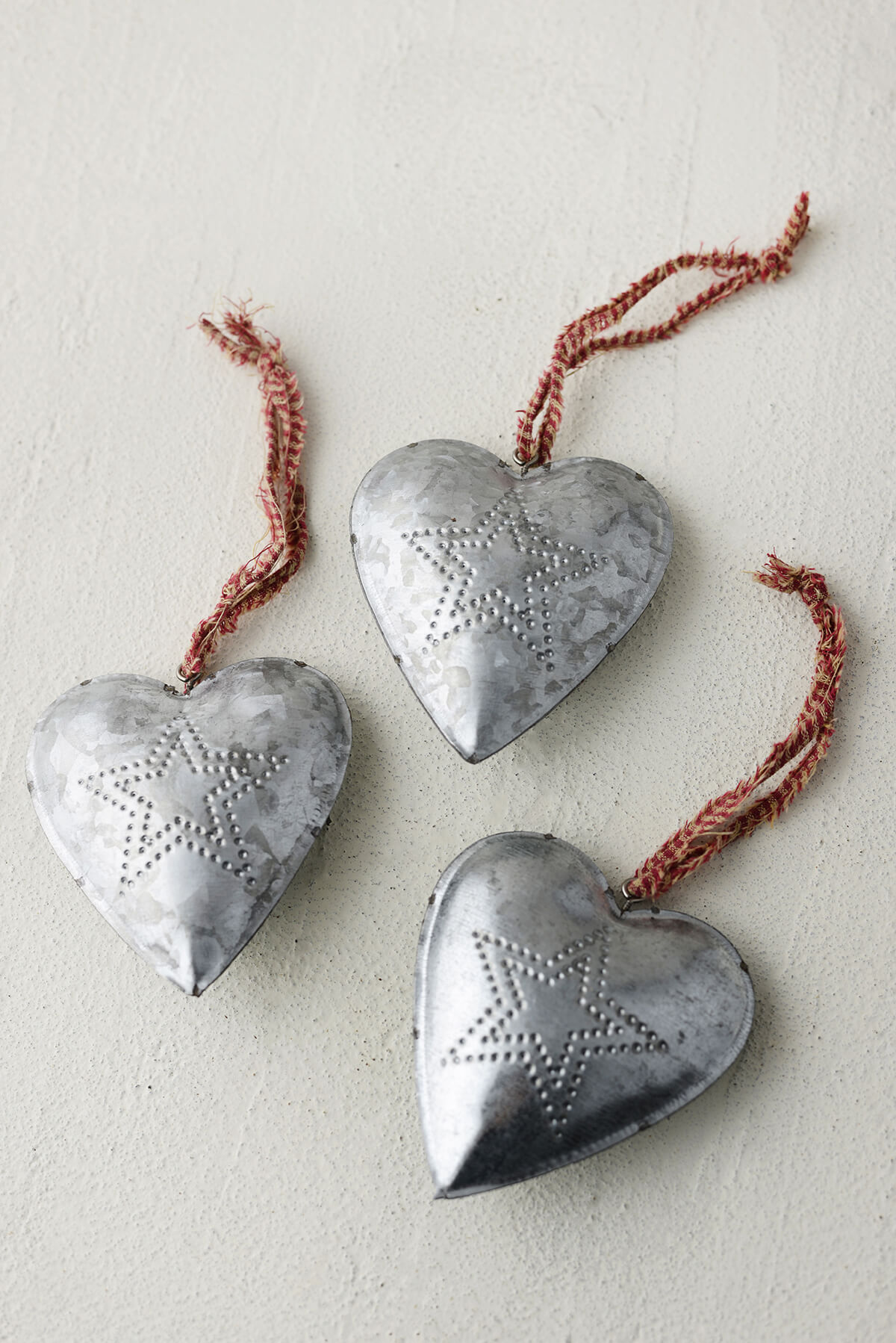 Tinwork heart favors hanging punched metal with