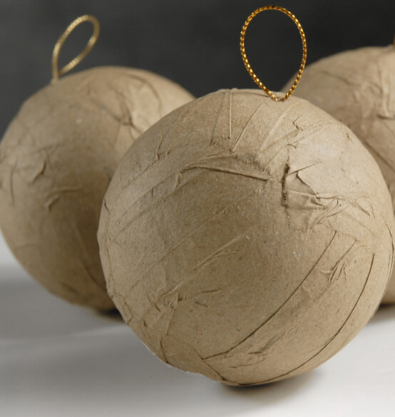 Decoupage paint and decorated these 3 quot paper mache balls each is