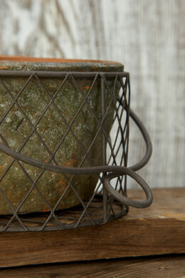 Rustic Pot in a Wire Basket