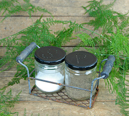 Salt and Pepper Jars in Rusted Metal Basket