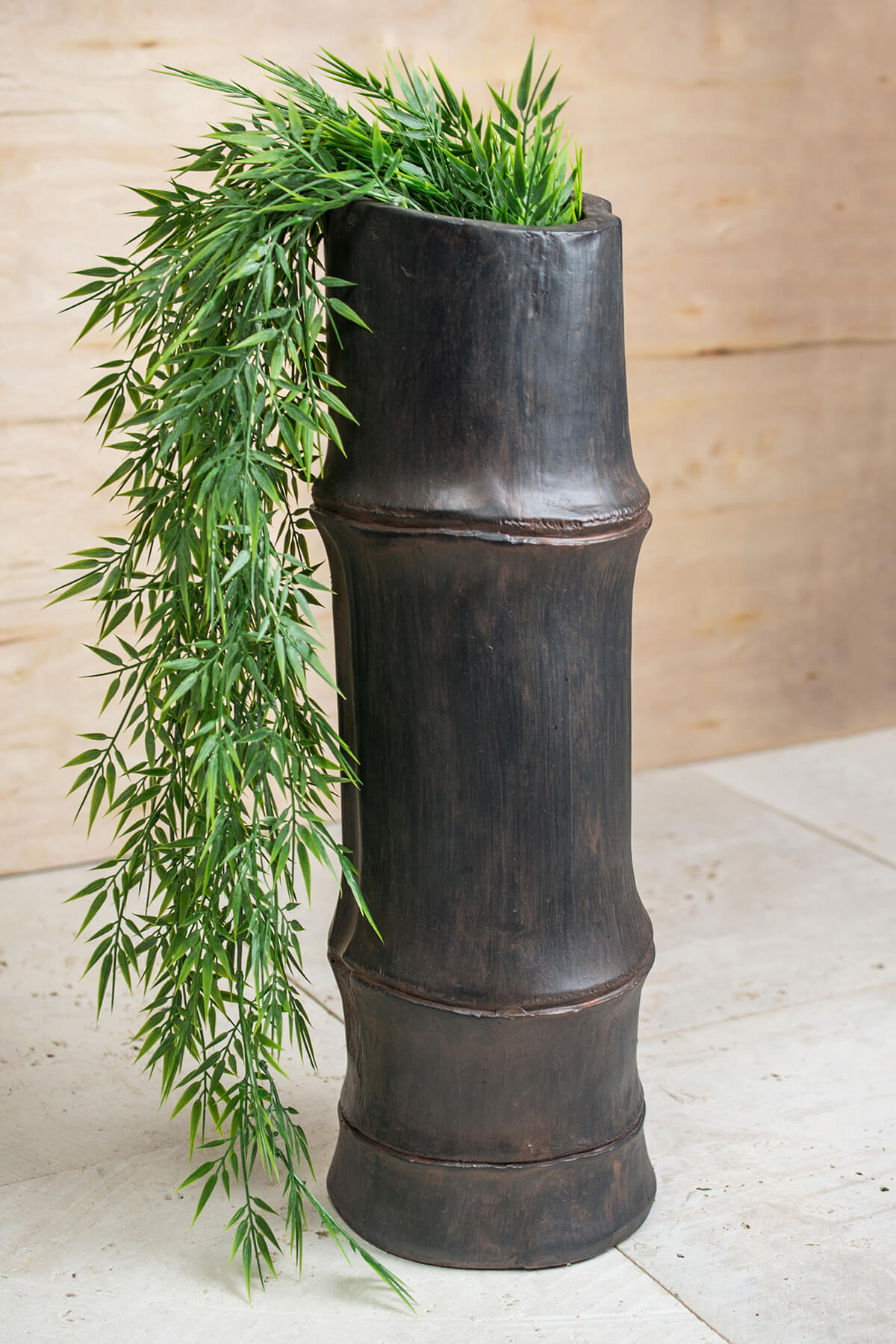 Tall in bamboo vase