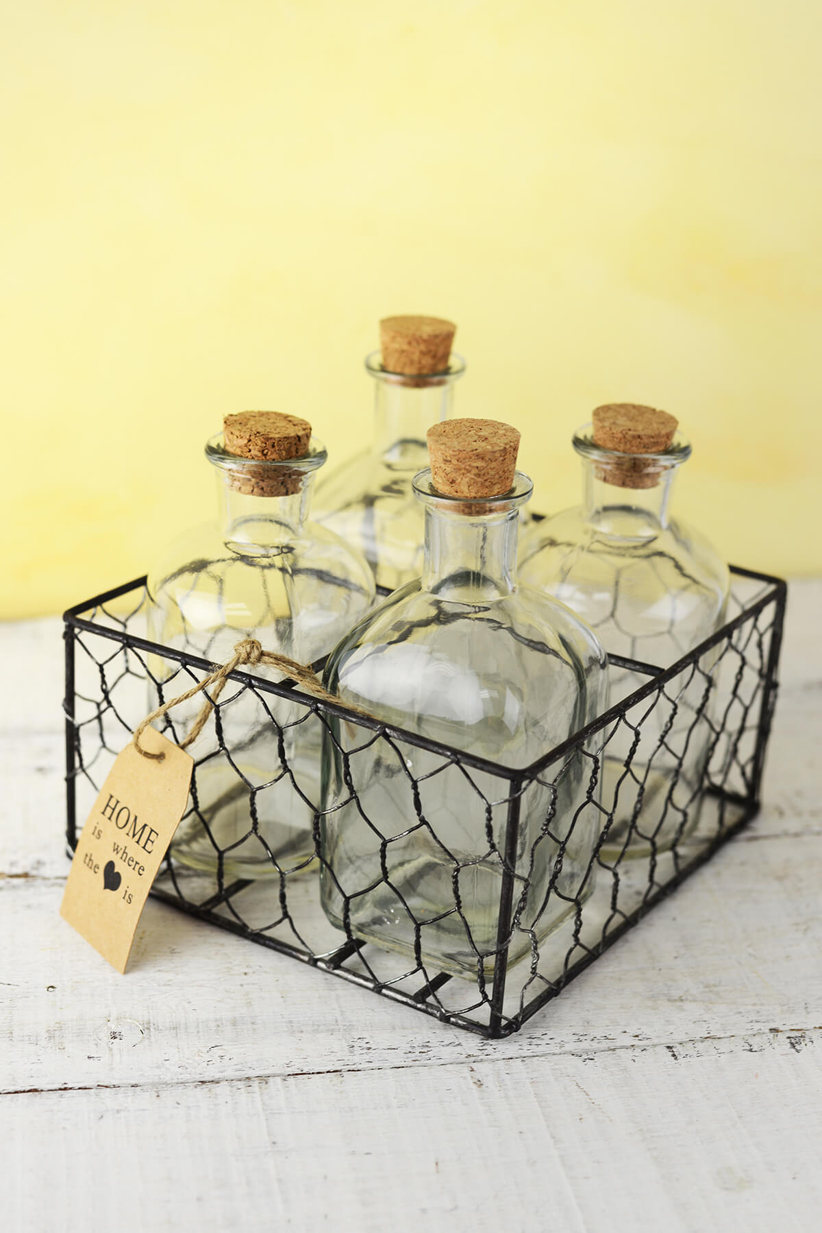 Four Glass Bottles in Chicken Wire Basket