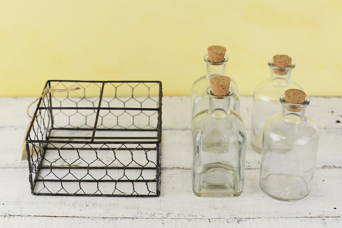 Four Glass Bottles in Chicken Wire Basket