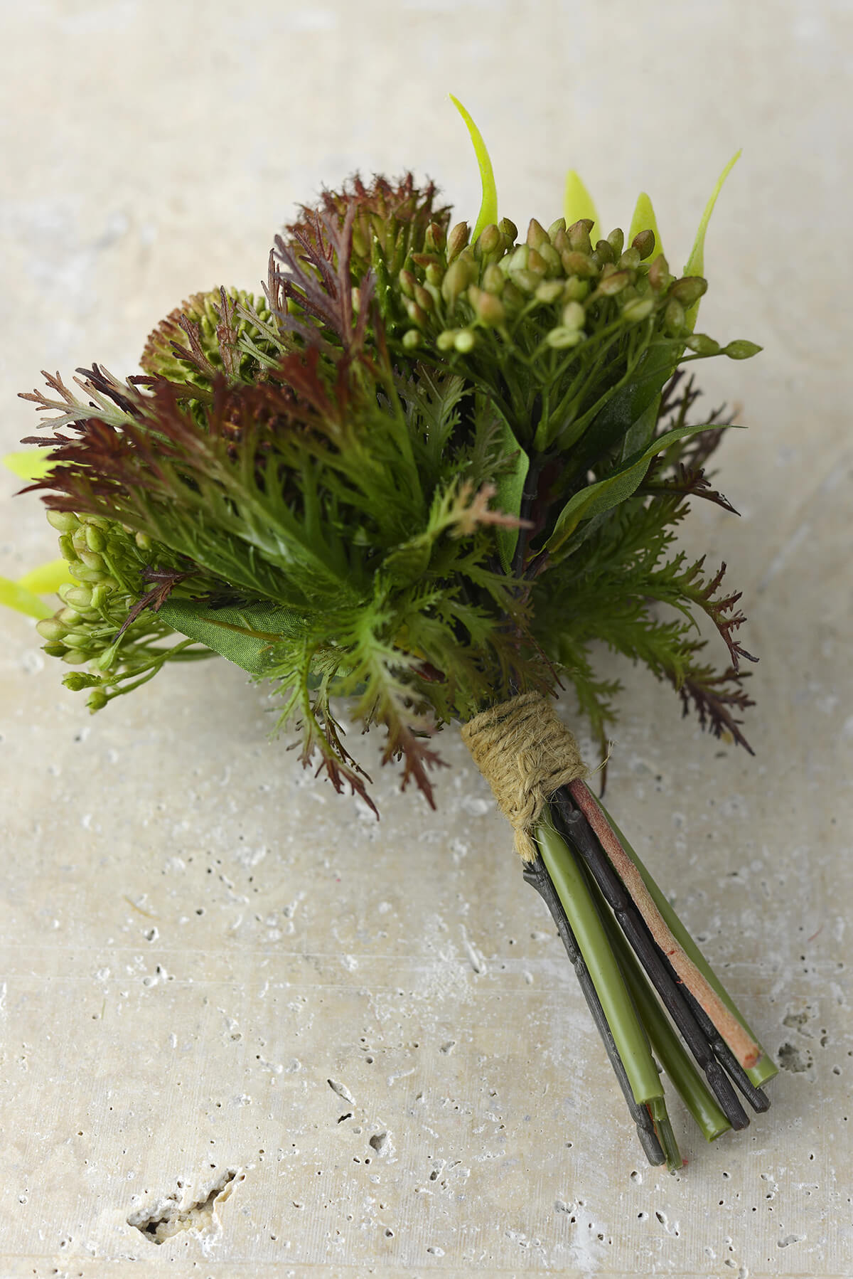 artificial protea  thistle  and sedum bouquet in green
