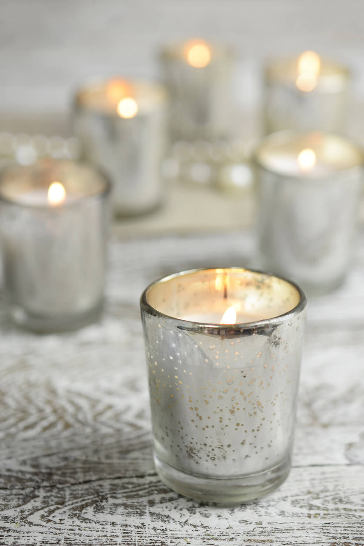 12 prefilled candles in mercury glass votive holders