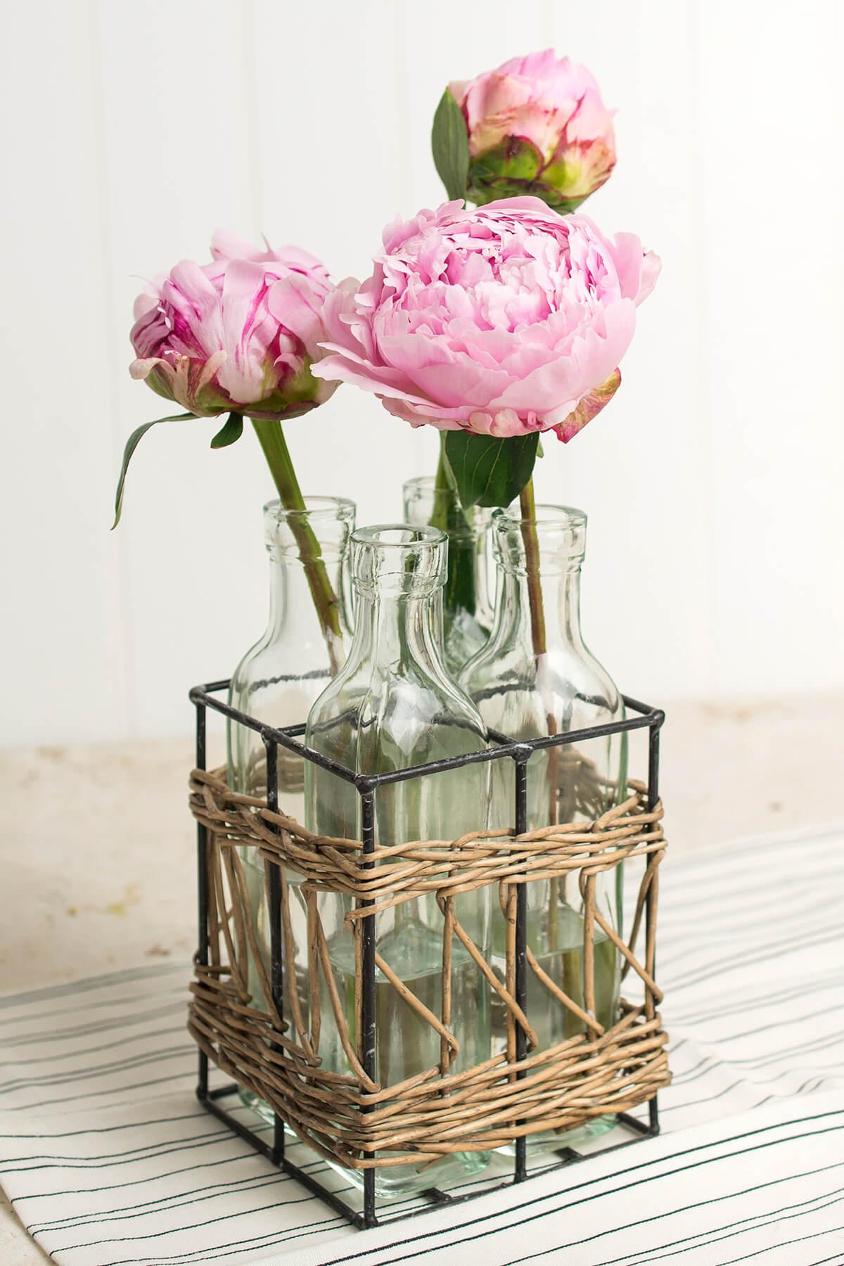 4 Glass Bottles in Willow Basket